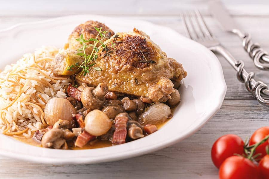 Rezept Geschmorte Hühnerkeulen mit Champignons