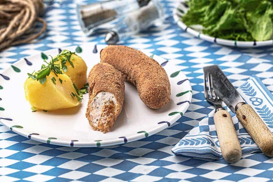 Rezept Gebackene Weißwurst im Breznmantel
